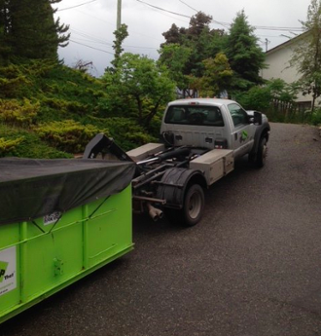 sloped surfaces can make roll-off dumpster rental use difficult